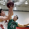 """Fairview High School's Gabe Tierney goes for a layup under the arms of Zach Rusk during a game against ThunderRidge High School on Wednesday, March 6, at Fairview High School in Boulder. For more photos of the game go to  <a href=""""http://www.dailycamera.com"""">http://www.dailycamera.com</a><br /> Jeremy Papasso/ Camera"""