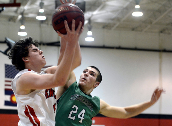 "Fairview High School's Gabe Tierney goes for a layup under the arms of Zach Rusk during a game against ThunderRidge High School on Wednesday, March 6, at Fairview High School in Boulder. For more photos of the game go to  <a href=""http://www.dailycamera.com"">http://www.dailycamera.com</a><br /> Jeremy Papasso/ Camera"