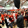 """Fairview High School students swarm the floor after Fairview defeated ThunderRidge with a buzzer beating three-pointer during a game on Wednesday, March 6, at Fairview High School in Boulder. Fairview won the game 55-52. For more photos of the game go to  <a href=""""http://www.dailycamera.com"""">http://www.dailycamera.com</a><br /> Jeremy Papasso/ Camera"""