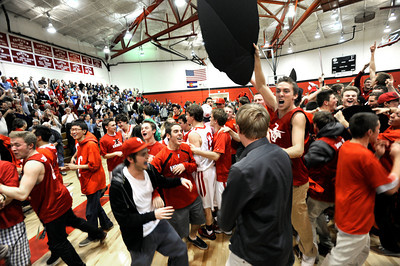 Fairview High School students swarm the floor after Fairview defeated ThunderRidge with a buzzer beating three-pointer during a game on Wednesday, March 6, at Fairview High School in Boulder. Fairview won the game 55-52. For more photos of the game go to www.dailycamera.com Jeremy Papasso/ Camera