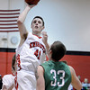 """Fairview High School's Austin Sparks takes a shot over Peter Howell during a game against ThunderRidge High School on Wednesday, March 6, at Fairview High School in Boulder. For more photos of the game go to  <a href=""""http://www.dailycamera.com"""">http://www.dailycamera.com</a><br /> Jeremy Papasso/ Camera"""