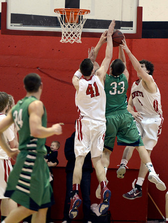"Fairview High School's Austin Sparks, No. 41, and Gabe Tierney, at right, work together to block the shot of Peter Howell during a game against ThunderRidge High School on Wednesday, March 6, at Fairview High School in Boulder. For more photos of the game go to  <a href=""http://www.dailycamera.com"">http://www.dailycamera.com</a><br /> Jeremy Papasso/ Camera"