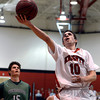 """Fairview High School's Trevor McQueeney drives to the hoop in front of Nolan Zarlin, No. 15, during a game against ThunderRidge High School on Wednesday, March 6, at Fairview High School in Boulder. For more photos of the game go to  <a href=""""http://www.dailycamera.com"""">http://www.dailycamera.com</a><br /> Jeremy Papasso/ Camera"""