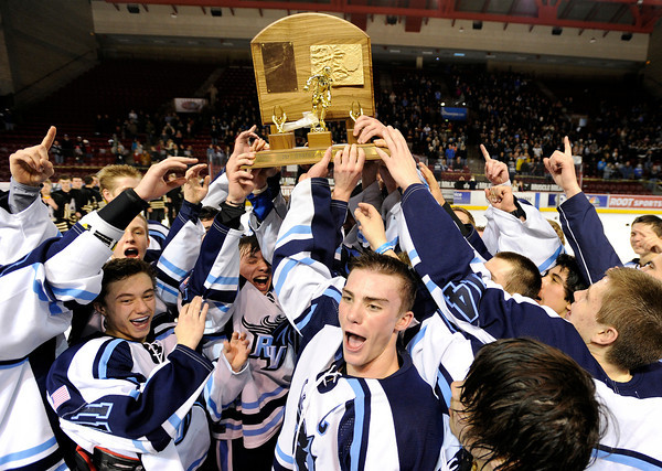 """The Ralston Valley hockey team celebrates with the championship trophy after defeating Monarch during the Colorado State Ice Hockey Championship game on Friday, March 1, at at Magness Arena in Denver. Monarch lost the game 5-1. For more photos of the game go to  <a href=""""http://www.dailycamera.com"""">http://www.dailycamera.com</a> <br /> Jeremy Papasso/ Camera"""