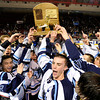 "The Ralston Valley hockey team celebrates with the championship trophy after defeating Monarch during the Colorado State Ice Hockey Championship game on Friday, March 1, at at Magness Arena in Denver. Monarch lost the game 5-1. For more photos of the game go to  <a href=""http://www.dailycamera.com"">http://www.dailycamera.com</a> <br /> Jeremy Papasso/ Camera"