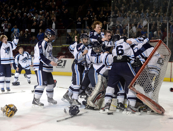 "Ralston Valley players celebrate victory at the goal after defeating Monarch during the Colorado State Ice Hockey Championship game on Friday, March 1, at at Magness Arena in Denver. Monarch lost the game 5-1. For more photos of the game go to  <a href=""http://www.dailycamera.com"">http://www.dailycamera.com</a> <br /> Jeremy Papasso/ Camera"
