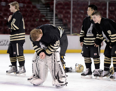 Monarch goalkeeper Ian Oden, center, shows his emotions after losing to Ralston Valley during the Colorado State Ice Hockey Championship on Friday, March 1, at at Magness Arena in Denver. Monarch lost the game 5-1. For more photos of the game go to www.dailycamera.com  Jeremy Papasso/ Camera