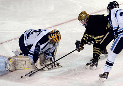 Monarch's Walker Harris tries to sneak the puck past goalkeeper Zach LaRocque during the Colorado State Ice Hockey Championship game against Ralston Valley on Friday, March 1, at at Magness Arena in Denver. Monarch lost the game 5-1. For more photos of the game go to www.dailycamera.com  Jeremy Papasso/ Camera
