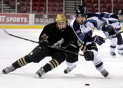 Monarch's Jake Christofferson, left, fights for the puck with Darius Maes during the Colorado State Ice Hockey Championship game against Ralston Valley on Friday, March 1, at at Magness Arena in Denver. Monarch lost the game 5-1. For more photos of the game go to www.dailycamera.com  Jeremy Papasso/ Camera
