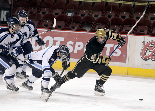 "Monarch's Gian Cervo, right, fights for the puck with Tanner West, center, during the Colorado State Ice Hockey Championship game against Ralston Valley on Friday, March 1, at at Magness Arena in Denver. Monarch lost the game 5-1. For more photos of the game go to  <a href=""http://www.dailycamera.com"">http://www.dailycamera.com</a> <br /> Jeremy Papasso/ Camera"
