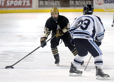 Monarch's Cameron Taggart moves the puck towards Brendan Aleksivich during the Colorado State Ice Hockey Championship game against Ralston Valley on Friday, March 1, at at Magness Arena in Denver. Monarch lost the game 5-1. For more photos of the game go to www.dailycamera.com  Jeremy Papasso/ Camera