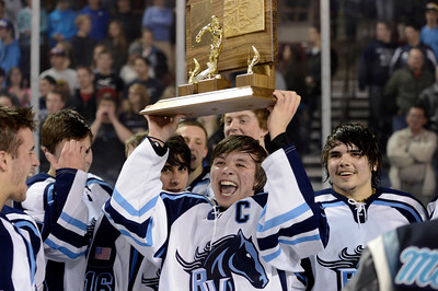Ralston Valley's Charles Joly holds the championship trophy after defeating Monarch during the Colorado State Ice Hockey Championship game on Friday, March 1, at at Magness Arena in Denver. Monarch lost the game 5-1. For more photos of the game go to www.dailycamera.com  Jeremy Papasso/ Camera