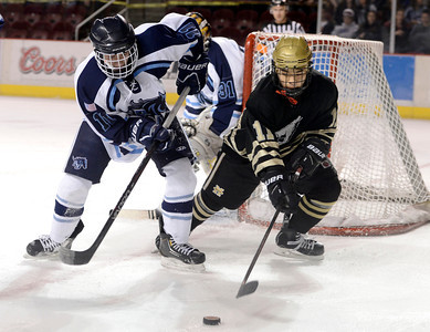 Monarch's Brett Kiyota, right, fights for the puck with Austin Resseguie during the Colorado State Ice Hockey Championship game against Ralston Valley on Friday, March 1, at at Magness Arena in Denver. Monarch lost the game 5-1. For more photos of the game go to www.dailycamera.com  Jeremy Papasso/ Camera