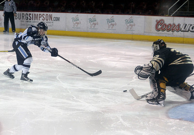 Ralston Valley's Victor Lombardi scores a goal on Monarch's Ian Oden during the Colorado State Ice Hockey Championship game on Friday, March 1, at at Magness Arena in Denver. Monarch lost the game 5-1. For more photos of the game go to www.dailycamera.com  Jeremy Papasso/ Camera