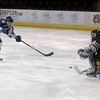 "Ralston Valley's Victor Lombardi scores a goal on Monarch's Ian Oden during the Colorado State Ice Hockey Championship game on Friday, March 1, at at Magness Arena in Denver. Monarch lost the game 5-1. For more photos of the game go to  <a href=""http://www.dailycamera.com"">http://www.dailycamera.com</a> <br /> Jeremy Papasso/ Camera"