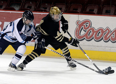 Monarch's Jake Orsborn moves the puck past Nick Wiemelt during the Colorado State Ice Hockey Championship game against Ralston Valley on Friday, March 1, at at Magness Arena in Denver. Monarch lost the game 5-1. For more photos of the game go to www.dailycamera.com  Jeremy Papasso/ Camera