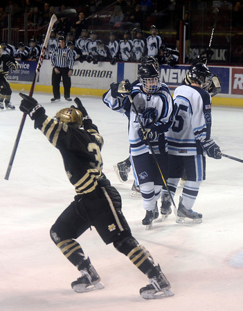 """Monarch's Alex Barber, left, celebrates a goal in front of Ralston Valley players during the Colorado State Ice Hockey Championship game against Ralston Valley on Friday, March 1, at at Magness Arena in Denver. Monarch lost the game 5-1. For more photos of the game go to  <a href=""""http://www.dailycamera.com"""">http://www.dailycamera.com</a> <br /> Jeremy Papasso/ Camera"""