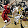 "Monarch High School's Jay Macintyre dribbles past David Schlecht during a game against Loveland High School on Tuesday, Feb. 5, at Monarch High School in Louisville. For more photos of the game go to  <a href=""http://www.dailycamera.com"">http://www.dailycamera.com</a><br /> Jeremy Papasso/ Camera"