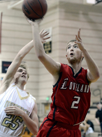 "Monarch High School's Erik Lawson tries to block the shot of Ryan Andrew during a game against Loveland High School on Tuesday, Feb. 5, at Monarch High School in Louisville. For more photos of the game go to  <a href=""http://www.dailycamera.com"">http://www.dailycamera.com</a><br /> Jeremy Papasso/ Camera"