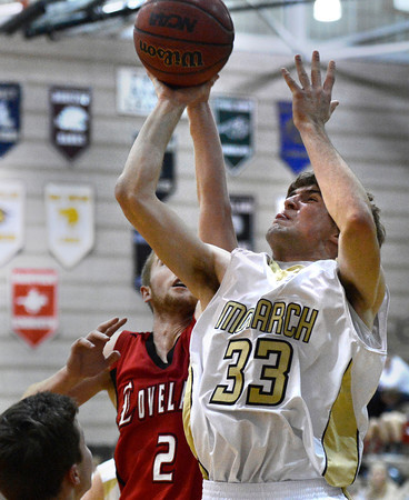 """Monarch High School's Jay Macintyre drives to the hoop in front of Ryan Andrew, No. 2, during a game against Loveland High School on Tuesday, Feb. 5, at Monarch High School in Louisville. For more photos of the game go to  <a href=""""http://www.dailycamera.com"""">http://www.dailycamera.com</a><br /> Jeremy Papasso/ Camera"""