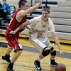 "Monarch High School's Ben Beauchamp dribbles past Jay Macintyre during a game against Loveland High School on Tuesday, Feb. 5, at Monarch High School in Louisville. For more photos of the game go to  <a href=""http://www.dailycamera.com"">http://www.dailycamera.com</a><br /> Jeremy Papasso/ Camera"