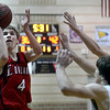 "Loveland High School's Brian Strasbaugh takes a shot over Monarch High School's Jay Macintyre, center, and Erik Lawson, right, during a game on Tuesday, Feb. 5, at Monarch High School in Louisville. For more photos of the game go to  <a href=""http://www.dailycamera.com"">http://www.dailycamera.com</a><br /> Jeremy Papasso/ Camera"