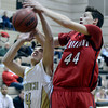 "Monarch High School's Kyle Billingsley gets his shot blocked by Conor Lang during a game against Loveland High School on Tuesday, Feb. 5, at Monarch High School in Louisville. For more photos of the game go to  <a href=""http://www.dailycamera.com"">http://www.dailycamera.com</a><br /> Jeremy Papasso/ Camera"