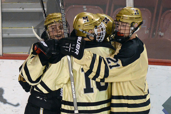 Monarch High School's Noah Zimmerman, left, celebrates with teammates after scoring a goal in the first period of a game against Regis Jesuit on Thursday, Feb. 28, 2013 at Magness Arena on the University of Denver campus.
