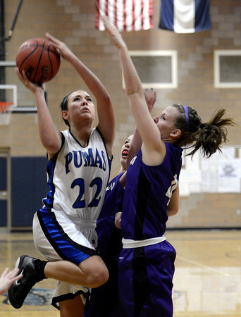 "Peak to Peak's Ivy DeVries takes a shot over Jessica Farra during a game against Lutheran High School on Wednesday, Jan. 30, at Peak to Peak Charter School in Lafayette. For more photos of the game go to  <a href=""http://www.dailycamera.com"">http://www.dailycamera.com</a><br /> Jeremy Papasso/ Camera"