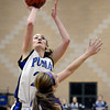 "Peak to Peak's Annette Warner takes a shot over Whitney Dettmering during a game against Lutheran High School on Wednesday, Jan. 30, at Peak to Peak Charter School in Lafayette. For more photos of the game go to  <a href=""http://www.dailycamera.com"">http://www.dailycamera.com</a><br /> Jeremy Papasso/ Camera"