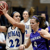 "Peak to Peak's Ivy DeVries, left, passes the ball in front of Jessica Farra, No. 4, during a game against Lutheran High School on Wednesday, Jan. 30, at Peak to Peak Charter School in Lafayette. For more photos of the game go to  <a href=""http://www.dailycamera.com"">http://www.dailycamera.com</a><br /> Jeremy Papasso/ Camera"