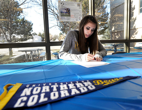 "Centaurus High School senior Shanlie Anderson signs her letter of intent to play soccer at the University of Northern Colorado on Friday, Feb. 8, at Centaurus High School in Lafayette. For more photos and video of Anderson signing her letter of intent go to  <a href=""http://www.dailycamera.com"">http://www.dailycamera.com</a><br /> Jeremy Papasso/ Camera"