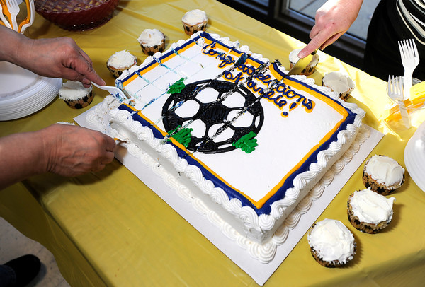 "People cut the cake for Centaurus High School senior Shanlie Anderson after she signed her letter of intent to play soccer at the University of Northern Colorado on Friday, Feb. 8, at Centaurus High School in Lafayette. For more photos and video of Anderson signing her letter of intent go to  <a href=""http://www.dailycamera.com"">http://www.dailycamera.com</a><br /> Jeremy Papasso/ Camera"