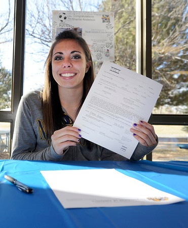 "Centaurus High School senior Shanlie Anderson holds her letter of intent to play soccer at the University of Northern Colorado on Friday, Feb. 8, at Centaurus High School in Lafayette. For more photos and video of Anderson signing her letter of intent go to  <a href=""http://www.dailycamera.com"">http://www.dailycamera.com</a><br /> Jeremy Papasso/ Camera"