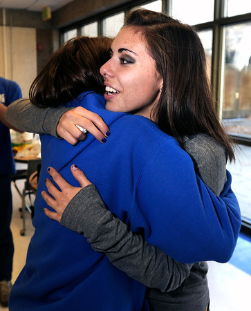 """Centaurus High School senior Shanlie Anderson, right, gets a hug from freshman Olivia Rogers after Anderson signed her letter of intent to play soccer at the University of Northern Colorado on Friday, Feb. 8, at Centaurus High School in Lafayette. For more photos and video of Anderson signing her letter of intent go to  <a href=""""http://www.dailycamera.com"""">http://www.dailycamera.com</a><br /> Jeremy Papasso/ Camera"""