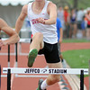 Loveland High School senior Joe Etling clears the final hurdle while competing in the 300-meter hurdles during the Class 5A State Track and Field Championships on Saturday, May 18, 2013 at Jeffco Stadium in Lakewood, Colo. (Photo by Steve Stoner)