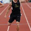Canon City's Zac McCoy crosses the finish line to win the 200-meter dash during the Class 4A State Track and Field Championships on Saturday, May 18, 2013 at Jeffco Stadium in Lakewood, Colo. (Photo by Steve Stoner)