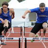 Lyons High School's Matt Radich, left, and Resurrection Christian's Cole Watson clear the final hurdle while competing in the 300-meter hurdles during the Class 2A State Track and Field Championships on Saturday, May 18, 2013 at Jeffco Stadium in Lakewood, Colo. (Photo by Steve Stoner)