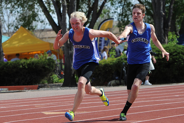 Resurrection Christian School's Brock Buxman, right, passes the baton to teammate Ryan Pehkonen while competing in the 400-meter relay during the Class 2A State Track and Field Championships on Saturday, May 18, 2013 at Jeffco Stadium in Lakewood, Colo. (Photo by Steve Stoner)