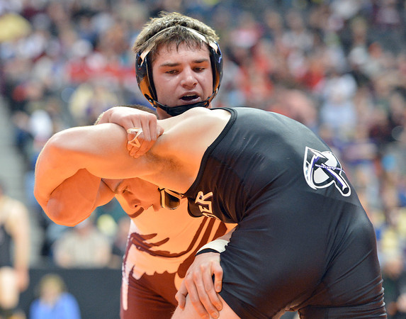 Jimmy Fate, Berthoud, left,  wrestling Bobby Amond, Cheyene Mountain in the 126-pound semi-final match in class 4A during the state wrestling championships at the Pepsi Center in Denver on Friday.<br /> February 22, 2013<br /> staff photo/ David R. Jennings