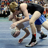"Broomfield High School's Darek Huff gets taken down by Discovery Canyon High School's Sam Turner during the Class 4A 106-pound match during the Colorado State Wrestling Championship semifinals on Friday, Feb. 22, at the Pepsi Center in Denver. Huff lost the match. For more photos of the tournament go to  <a href=""http://www.dailycamera.com"">http://www.dailycamera.com</a><br /> Jeremy Papasso/ Camera"