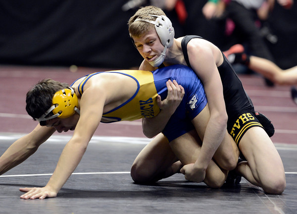 "Thompson Valley High School's Collin Williams tries to flip Frederick's Jesse Ortiz during the Class 4A 113-pound match during the Colorado State Wrestling Championship quarterfinals on Friday, Feb. 22, at the Pepsi Center in Denver. Williams won the match. For more photos of the tournament go to  <a href=""http://www.dailycamera.com"">http://www.dailycamera.com</a><br /> Jeremy Papasso/ Camera"