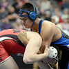 "Longmont High School's Jaime Ramos Vega, right, ties up with Arvada's Garet Krohn during the Class 4A 195-pound match during the Colorado State Wrestling Championship semifinals on Friday, Feb. 22, at the Pepsi Center in Denver. For more photos of the tournament go to  <a href=""http://www.dailycamera.com"">http://www.dailycamera.com</a><br /> Jeremy Papasso/ Camera"