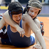 "Fort Morgan High School's Ian Wingstrom bends the fingers of Pueblo Central's Brandon Aragon during the Class 4A 126-pound match during the Colorado State Wrestling Championship quarterfinals on Friday, Feb. 22, at the Pepsi Center in Denver. For more photos of the tournament go to  <a href=""http://www.dailycamera.com"">http://www.dailycamera.com</a><br /> Jeremy Papasso/ Camera"