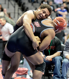 Loveland High School's Dalton Weis, top, tries to takedown Eaglecrest High School's Trevon Beauford during the Class 5A 182-pound match during the Colorado State Wrestling Championship quarterfinals on Friday, Feb. 22, at the Pepsi Center in Denver. For more photos of the tournament go to www.dailycamera.com Jeremy Papasso/ Camera