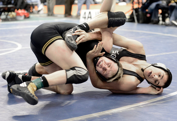 "Thompson Valley High School's Tanner Williams tries to avoid being flipped to his back by Pueblo South's Isaac Naro during the Class 4A 132-pound match during the Colorado State Wrestling Championship semifinals on Friday, Feb. 22, at the Pepsi Center in Denver. For more photos of the tournament go to  <a href=""http://www.dailycamera.com"">http://www.dailycamera.com</a><br /> Jeremy Papasso/ Camera"