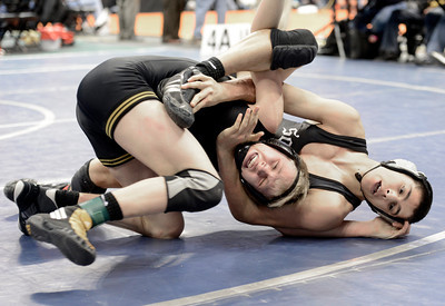 Thompson Valley High School's Tanner Williams tries to avoid being flipped to his back by Pueblo South's Isaac Naro during the Class 4A 132-pound match during the Colorado State Wrestling Championship semifinals on Friday, Feb. 22, at the Pepsi Center in Denver. For more photos of the tournament go to www.dailycamera.com Jeremy Papasso/ Camera