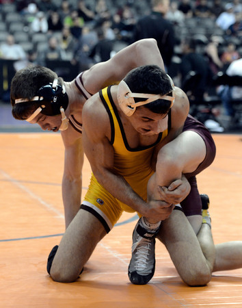 "Berthoud High School's Jimmy Fate, top, runs out the clock while wrestling Thomas Jefferson's Layth Dieyleh during the Class 4A 126-pound match during the Colorado State Wrestling Championship quarterfinals on Friday, Feb. 22, at the Pepsi Center in Denver. Fate won the match. For more photos of the tournament go to  <a href=""http://www.dailycamera.com"">http://www.dailycamera.com</a><br /> Jeremy Papasso/ Camera"