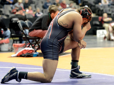 Loveland High School's Dalton Weis says a prayer before wrestling Eaglecrest High School's Trevon Beauford during the Class 5A 182-pound match during the Colorado State Wrestling Championship quarterfinals on Friday, Feb. 22, at the Pepsi Center in Denver. For more photos of the tournament go to www.dailycamera.com Jeremy Papasso/ Camera
