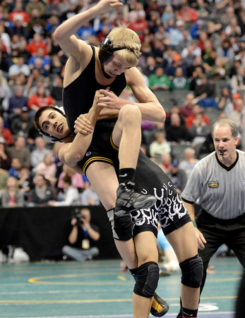 "Thompson Valley High School's Tanner Williams gets slammed by Pueblo South's Isaac Naro during the Class 4A 132-pound match during the Colorado State Wrestling Championship semifinals on Friday, Feb. 22, at the Pepsi Center in Denver. For more photos of the tournament go to  <a href=""http://www.dailycamera.com"">http://www.dailycamera.com</a><br /> Jeremy Papasso/ Camera"